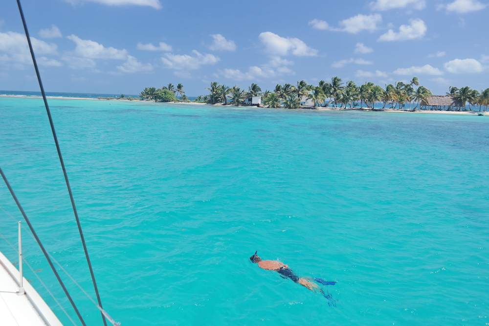 exploring Laughing Bird Caye's snorkeling spots