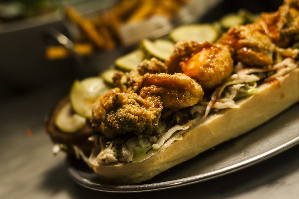 Fried Willapa Bay Oyster Po' Boy w/ Pop's Slaw, House Pickles, Creole Mayo & Fresno Hot Sauce