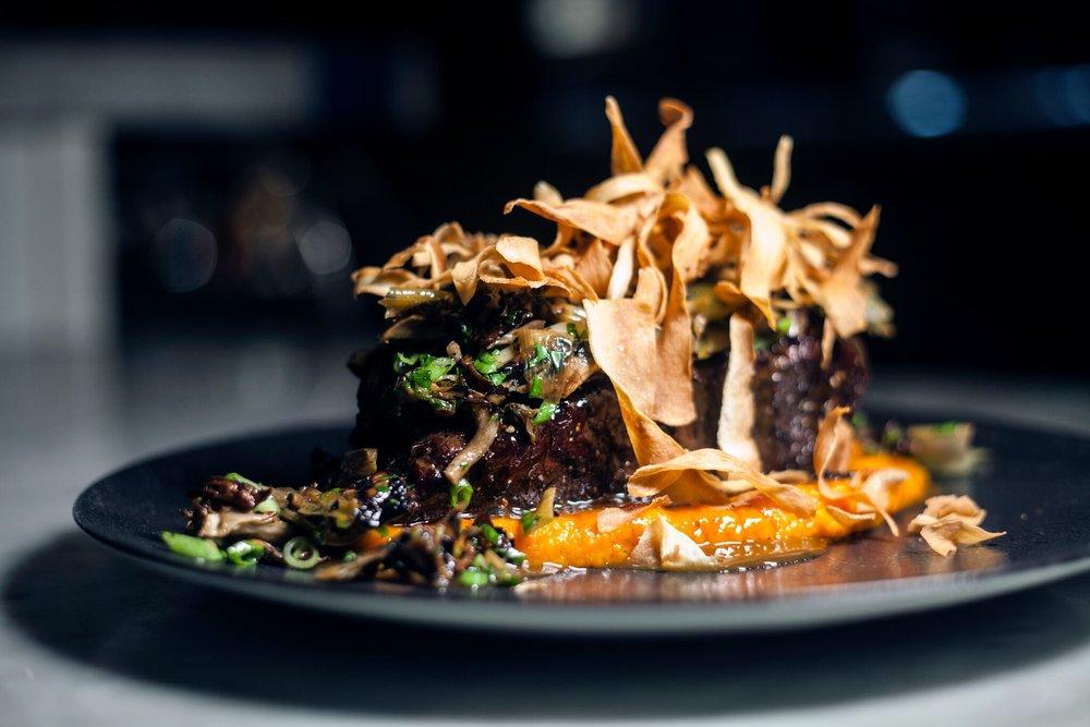 36 Hour Prime Boneless Beef Rib w/ Garnet Yam Purée, Maitake-Leek Verde, Crispy Parsnips & Potlikker Demi