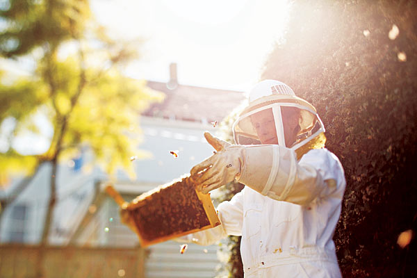 Kelly McKaig and her bees, via  Chicago Mag.com