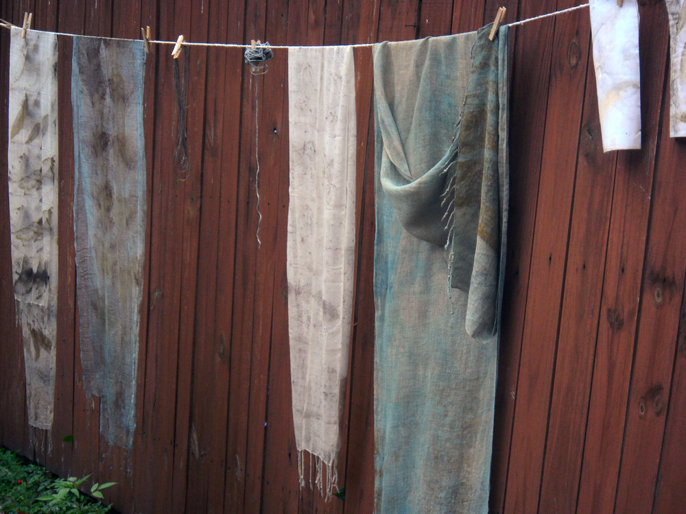 Left to right, Peach leaves on wool overdyed with indigo, peach leaves on wool, rose on wool scarf, indigo and rust on linen.