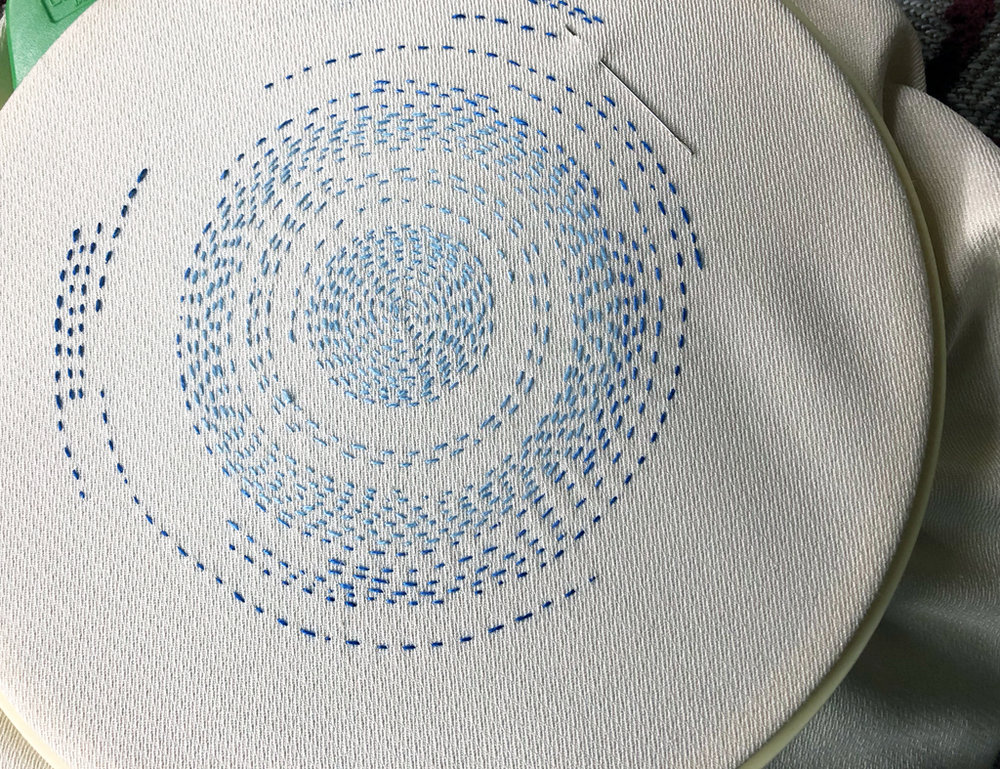 And here is the same piece as of last evening. I've added 2 more shades of blue as the circle expands.