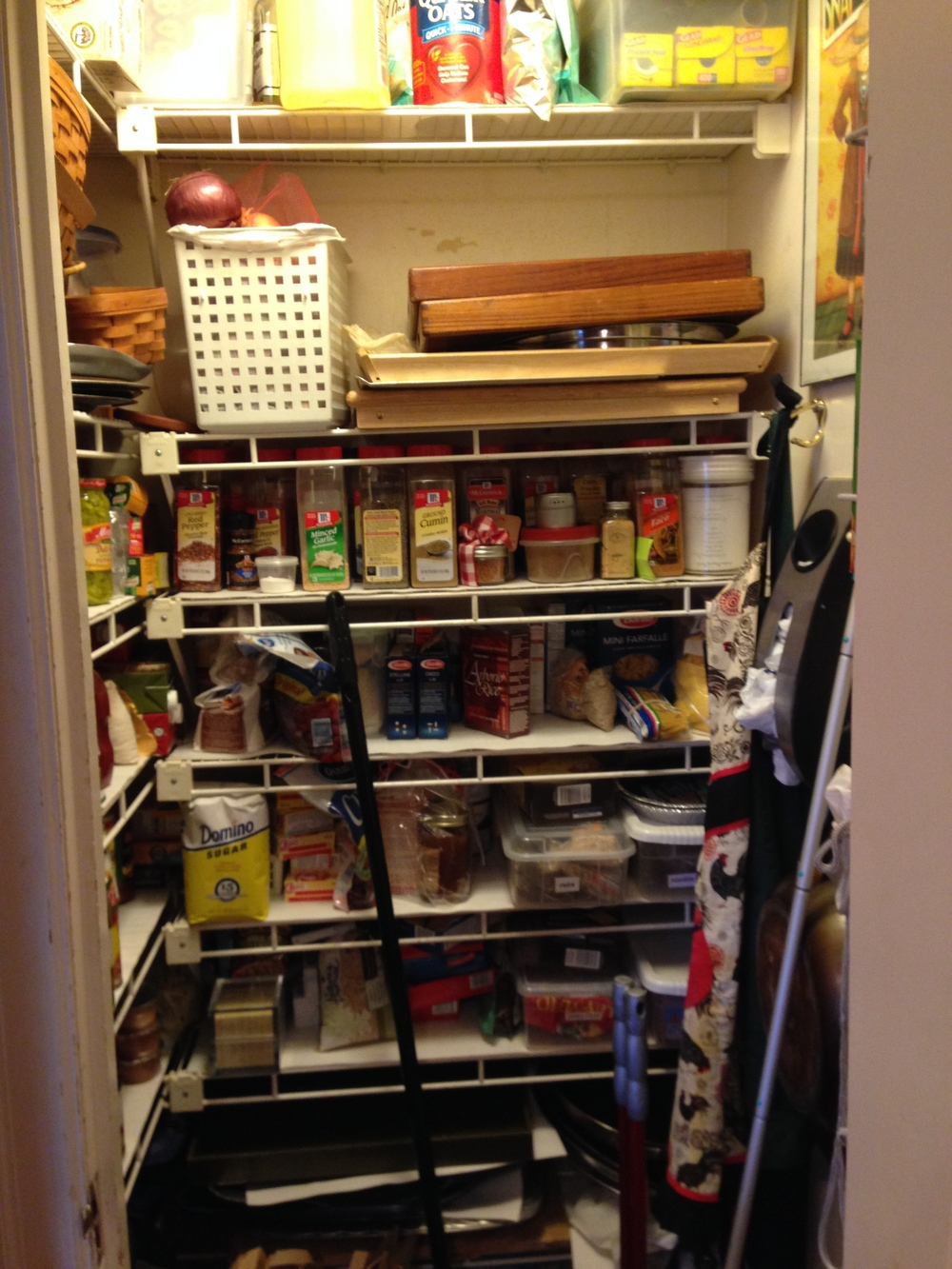This is my old pantry - I hated the trays all stacked on each other and the overhang on the shelves. It was so hard to see what I had and what I needed to buy. Can you see the peeling paint? Ick.