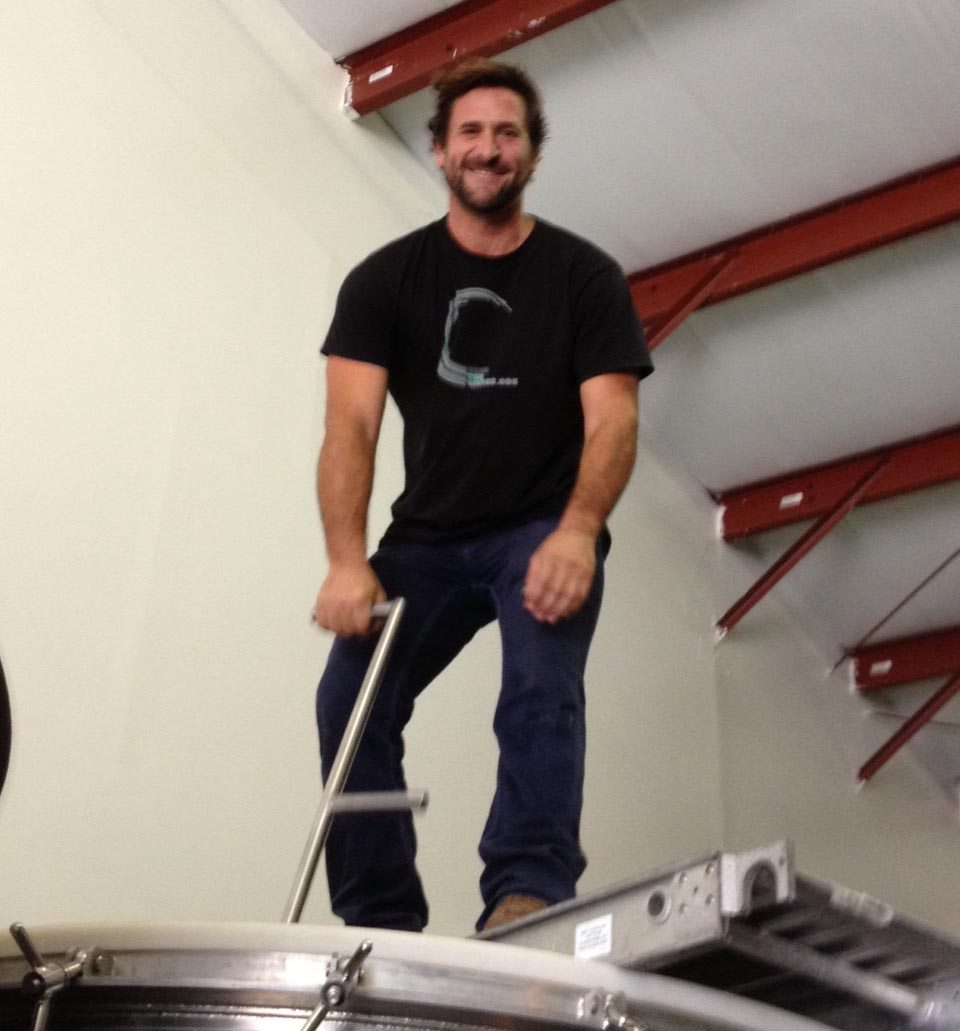 Co-owner Will Henry manages the heavy lifting, or punching in this case