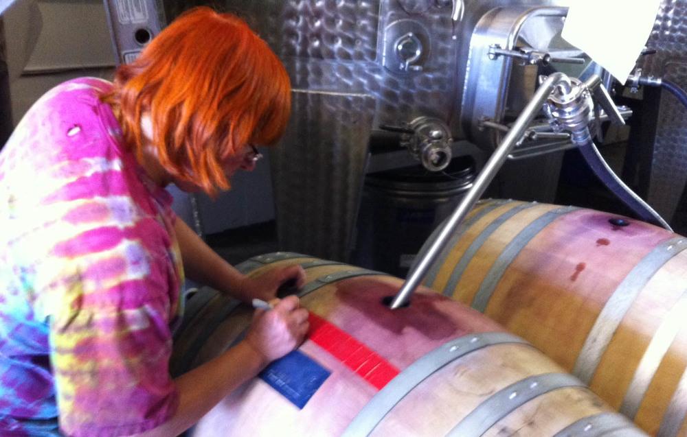 Lane tops up a barrel of 2013 Lumen Pinot Noir.