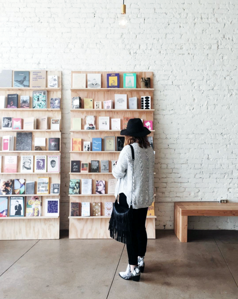 The art book wall at Eightfold Coffee Shop