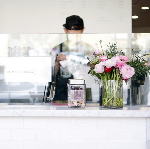 Eightfold Coffee Shop in Los Angeles - A beautiful coffee shop with white brick walls and beautiful flower bouquets handmade by the owner!