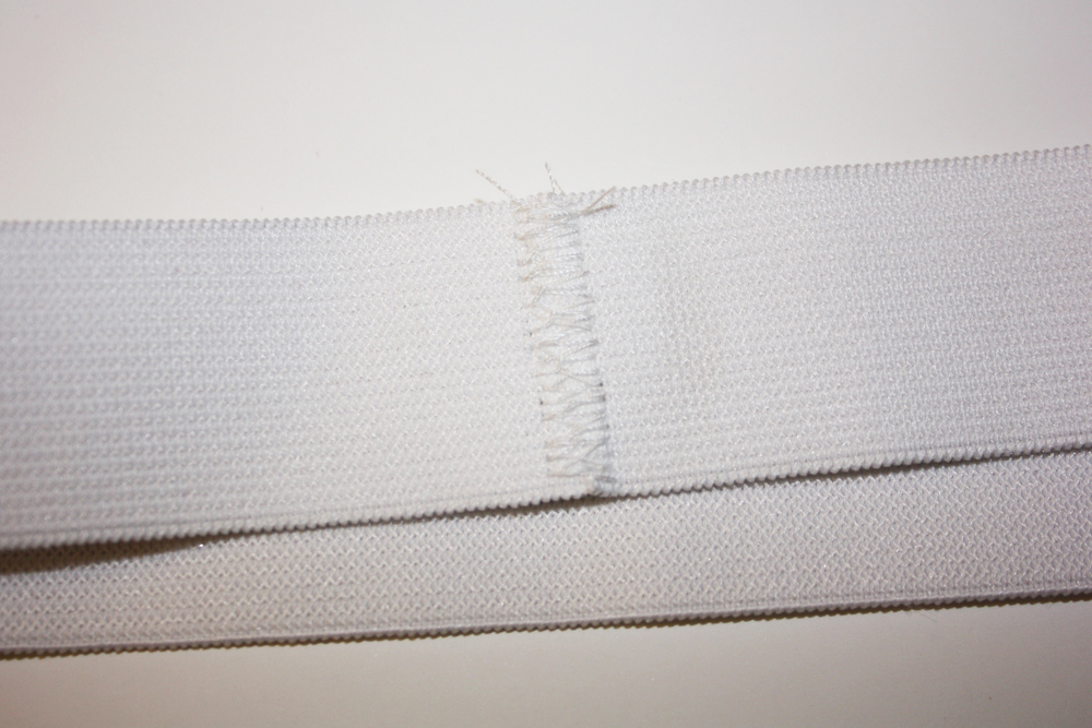 (Steps 15 - 17) Stitch ends of elastic together using a zigzag stitch.  Mark in quarters and mark waist opening in quarters.