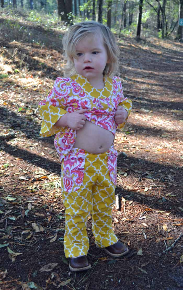 Resist the urge to blow raspberries on her cute tummy!