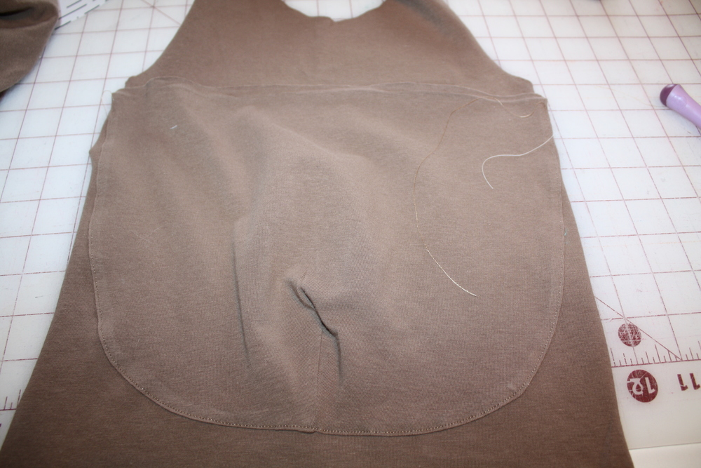 37b43b899 I continued assembling the romper as directed in the pattern until it was  time to stitch up the sides. This is where I stuffed the belly and closed  up the ...