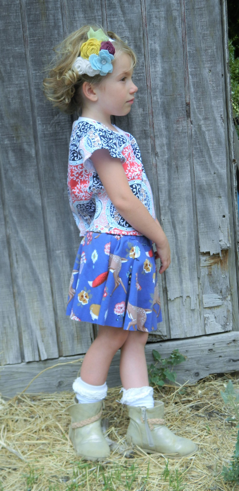 Swing Set Skort, Butterfly Blouse, and Coco Flower crown sewn by Nicole