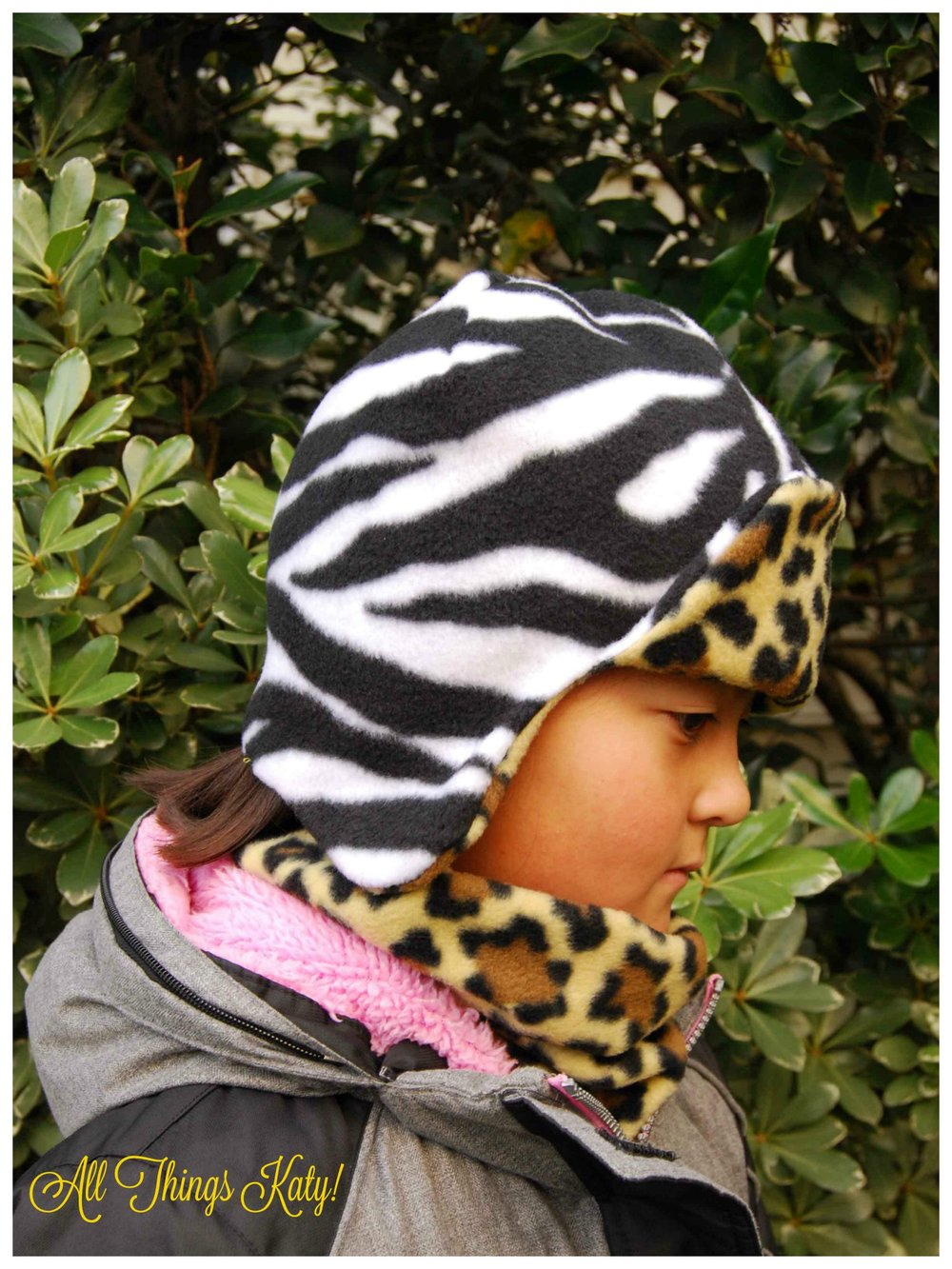fleece_acc_zebra_hat_side_wm.jpg