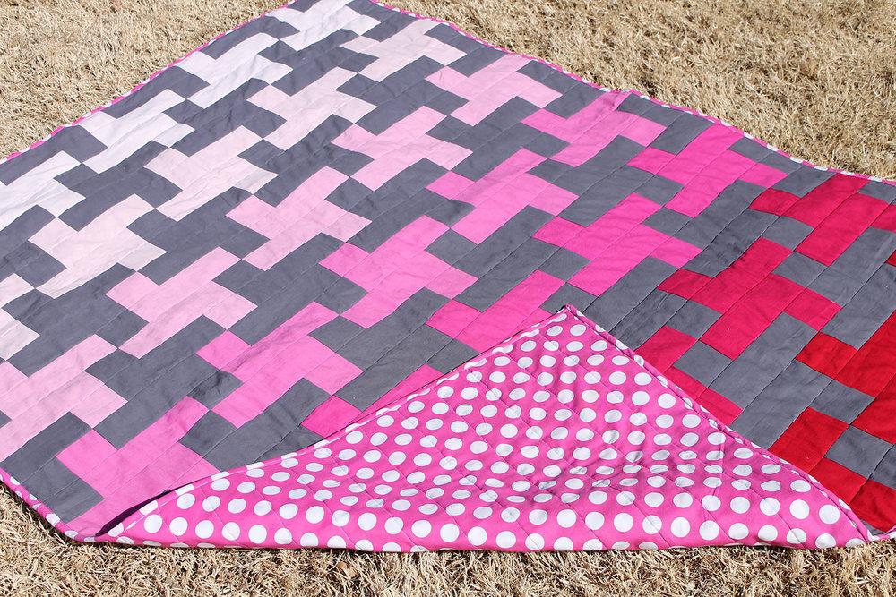 close up quilt on ground.jpg