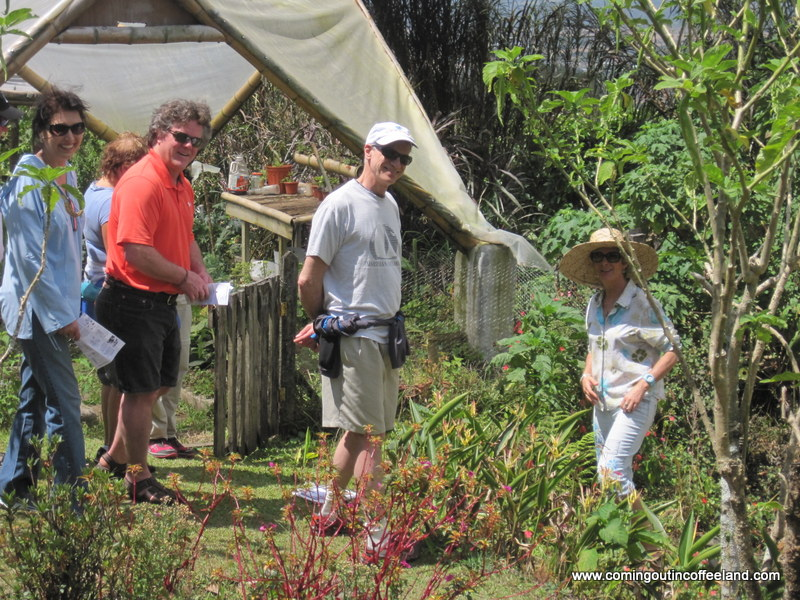 Dianne teaching visitors about plants.JPG