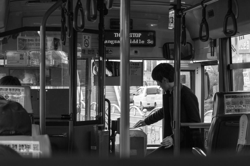 Riding the bus in Gwangju.