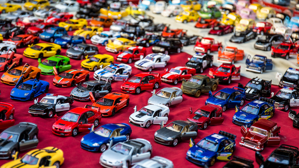 Model cars in a marketplace.