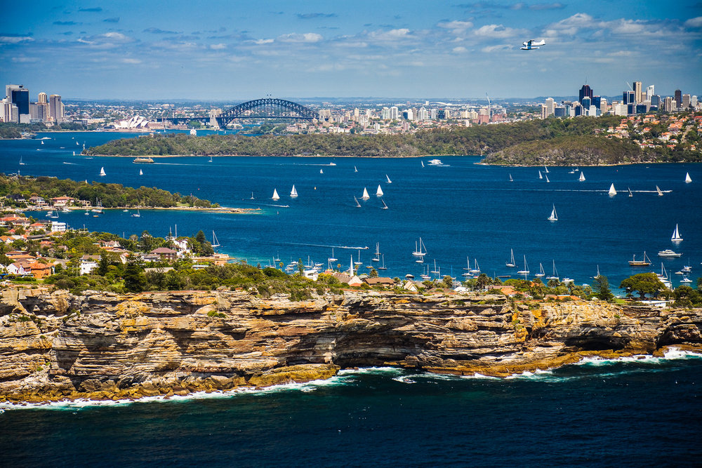 View of South Head in Sydney with a seaplane about to land.
