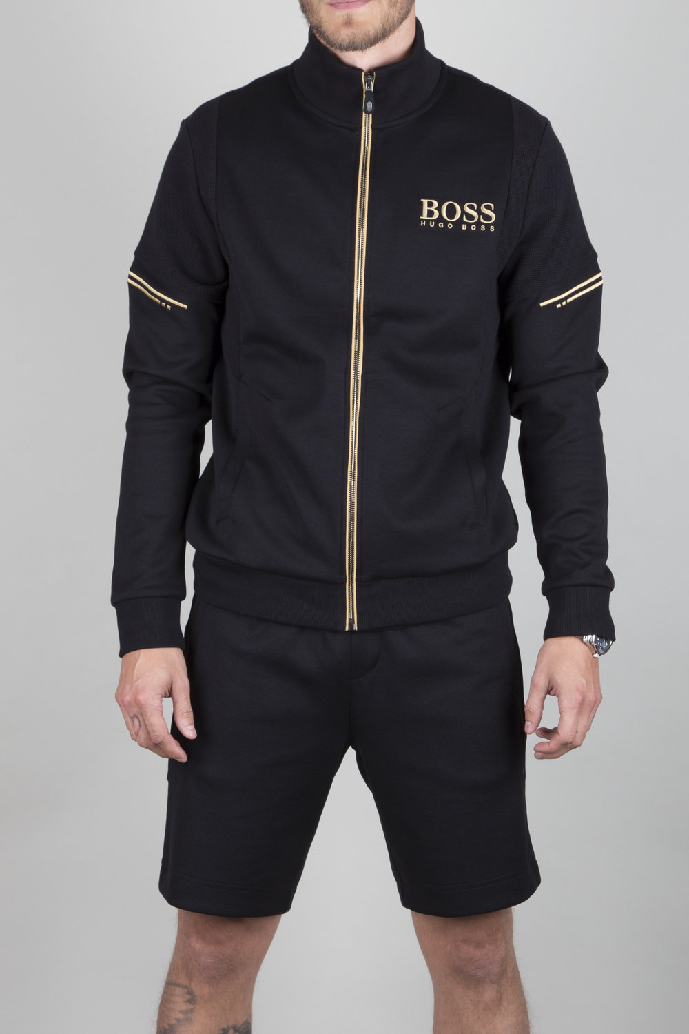 The iconic co-ordinating athleisure pieces, presented in black with frozen gold highlights, give a contemporary look. Yet adaptable for sports and active days.