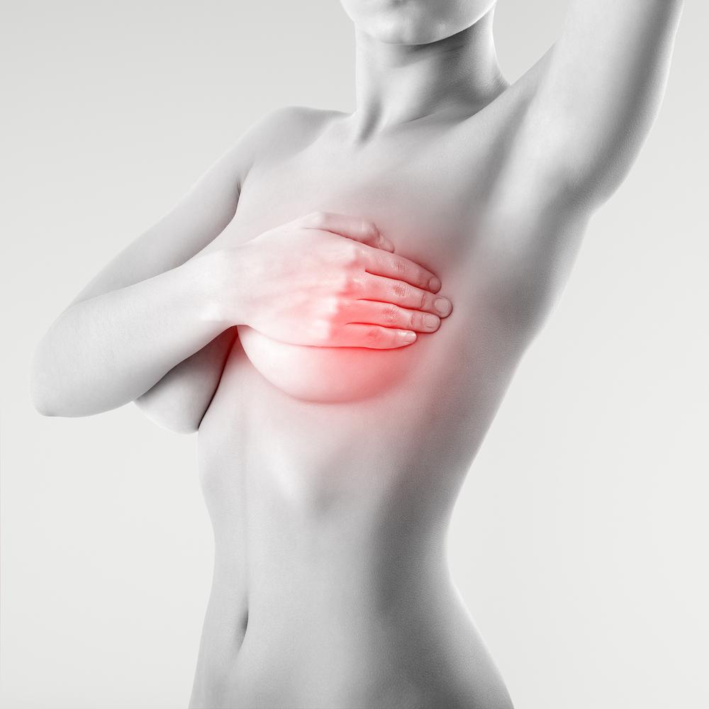 bigstock-woman-examining-breast-mastopa-28599599.jpg