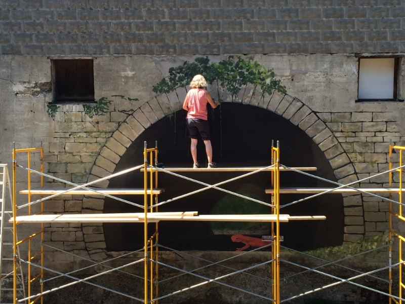 I'm getting used to working on the top of the scaffold and have put in more of the greenery and the first amphibian has been roughed in at the edge of the tunnel.