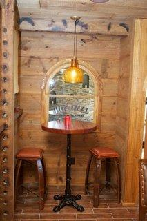 Barn Style Walls, Ceiling and Beams. Edmund Terrence Pub Table and Wine Beam