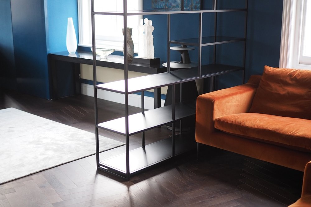 black metal frame shelving unit glass.jpg