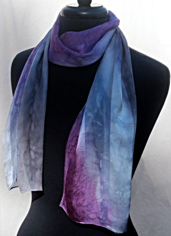 One of your gifts with purchase when you spend $500 or more, a luxury hand painted Joy Silk scarf