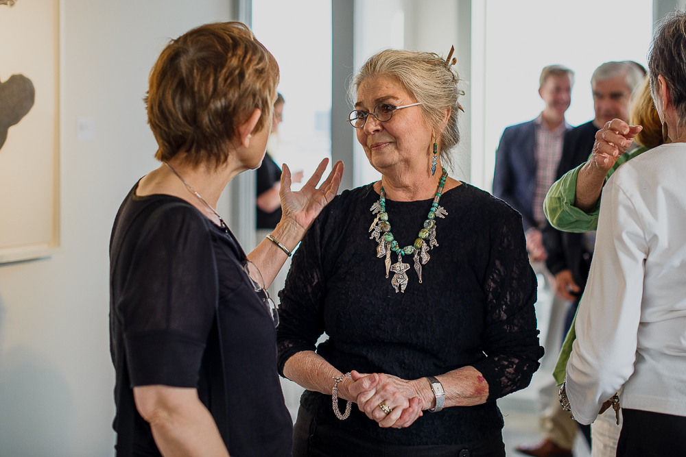 The woman herself, Ellen Soderquist, speaking with a friend at the exhibition's reception.