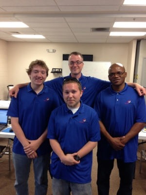 Instructor Marc Colburn with graduates Charles Murrell, Herman Williams, and Jared Lathrop.