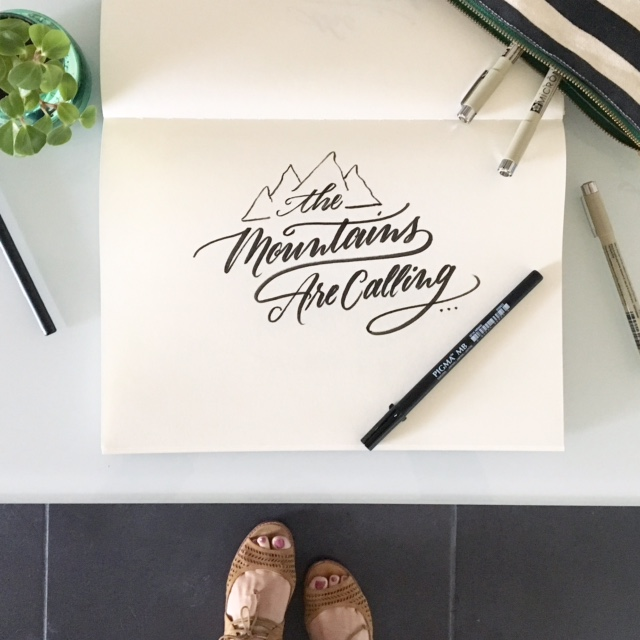 mountains calling brush lettering