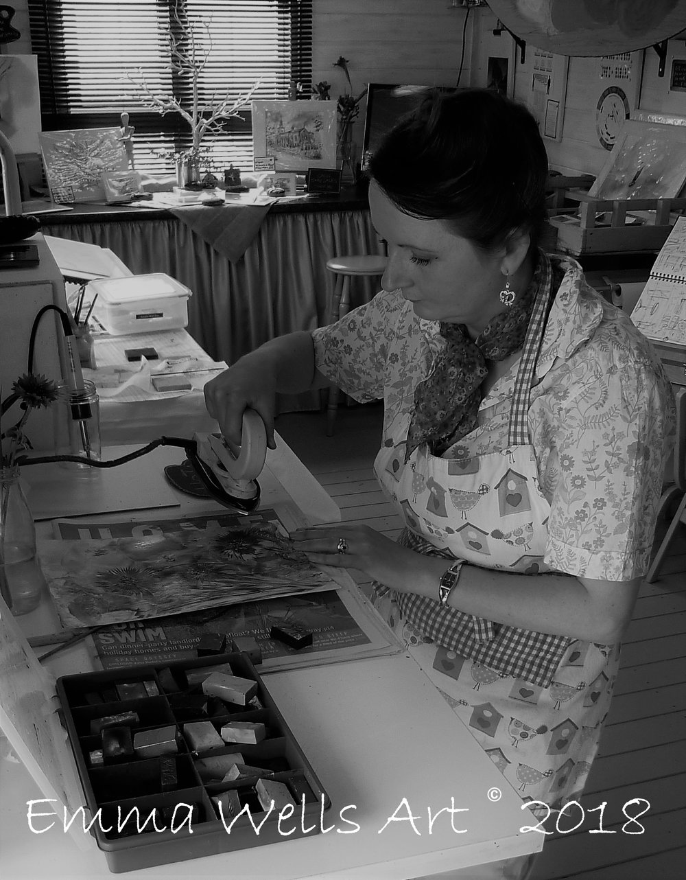Emma Wells creating encaustic wax art in her studio.