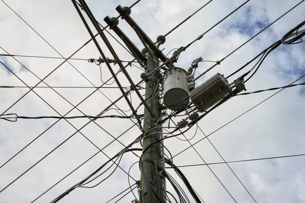bigstock-Power-Pole-With-Many-Wires-And-237320395.jpg