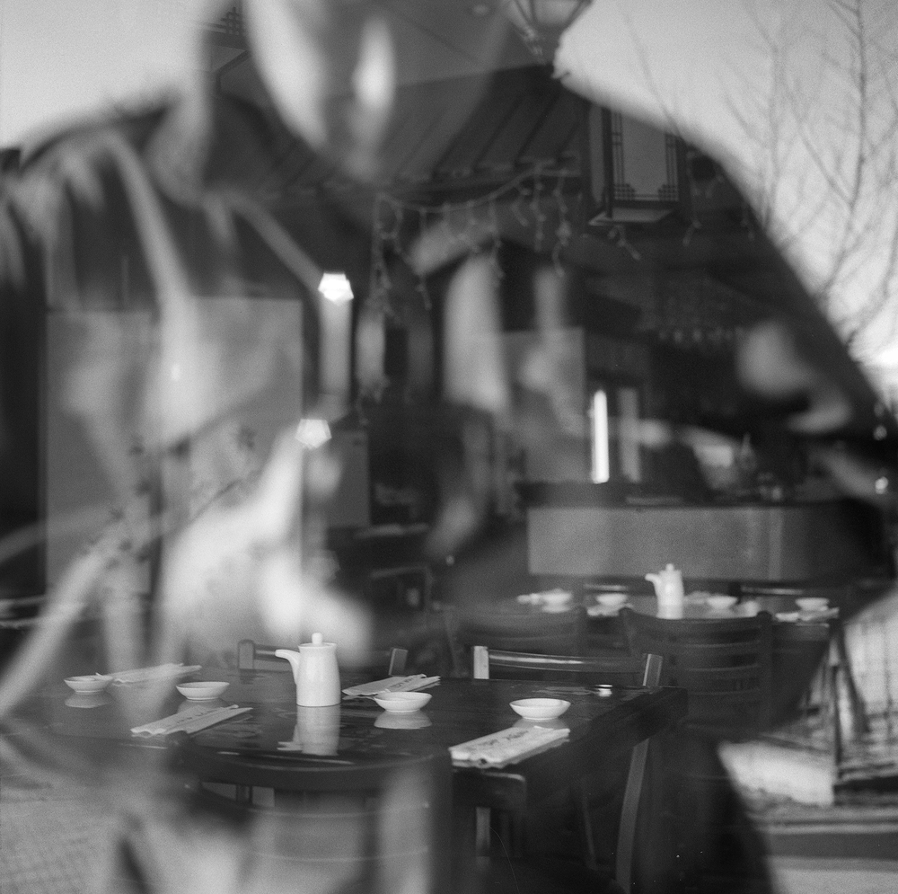 Self-portrait in store front window Hasselbald 500C, 80mm f/2.8 lens, and Ilford FP4+ black and white film