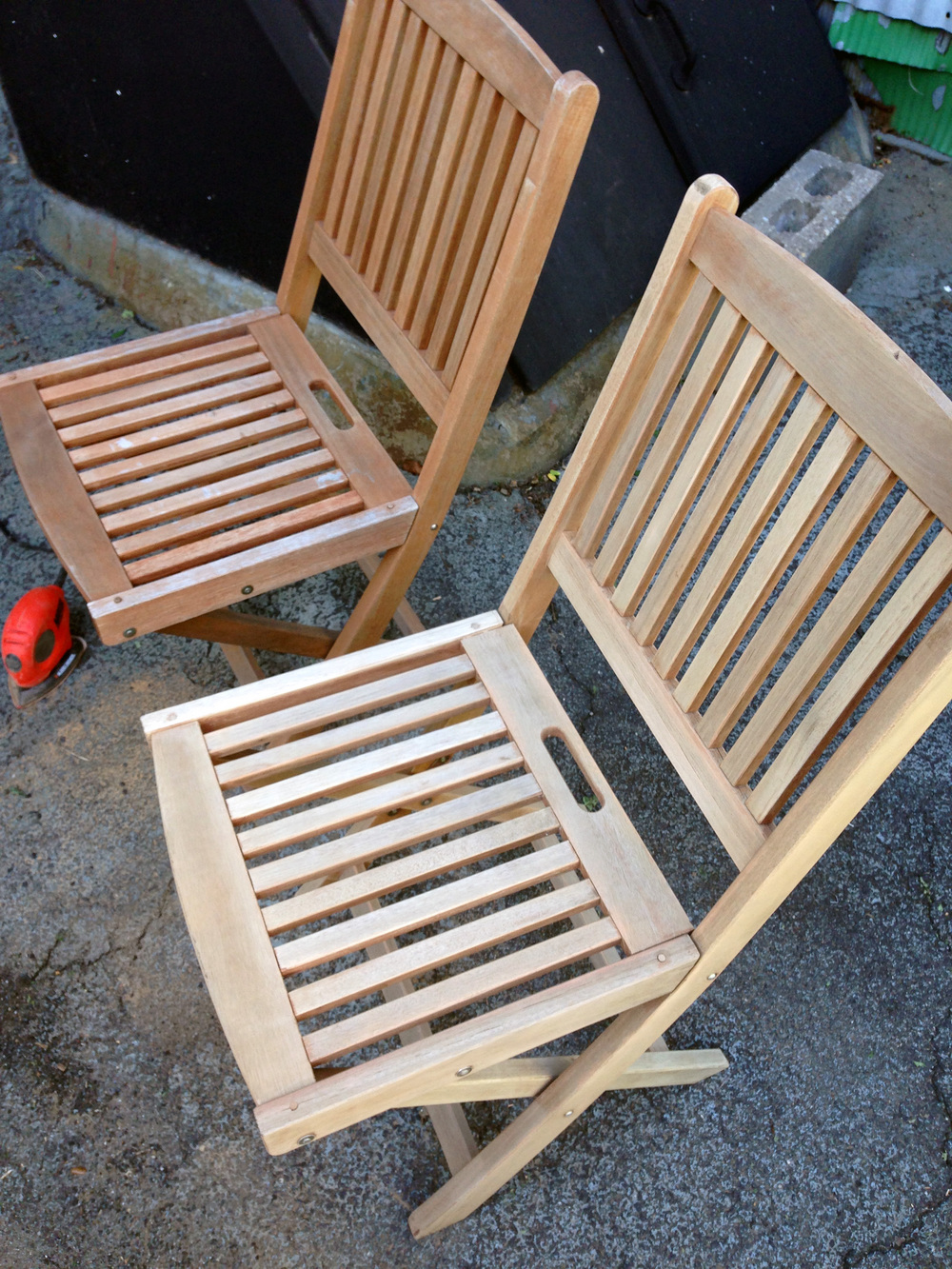 {sanding complete on the bottom chair shown}