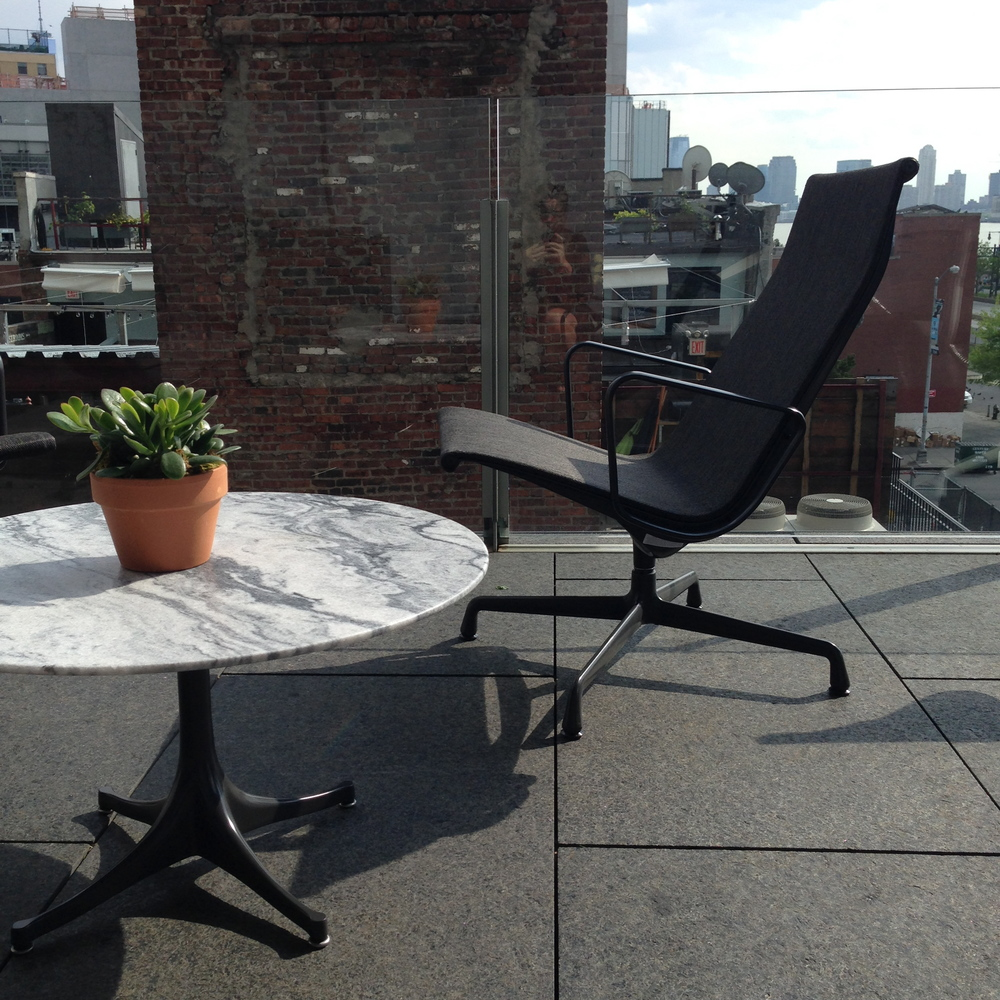 Eames Aluminum Group Chair with Nelson Pedestal Table, both for outdoors