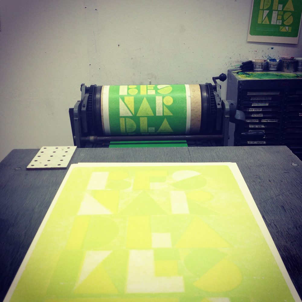 View of third color being printed on the Vandercook press.