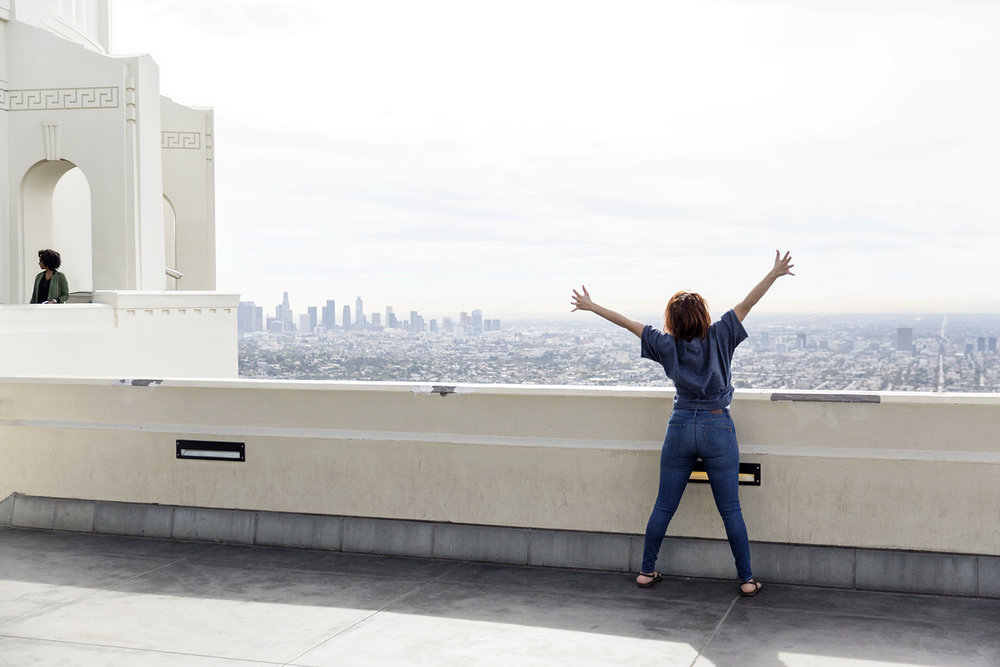 A woman enjoys the view over Los Angeles from the Griffith Observatory by Rebecca Stumpf Colorado Denver Boulder Editorial and Commercial Photographer