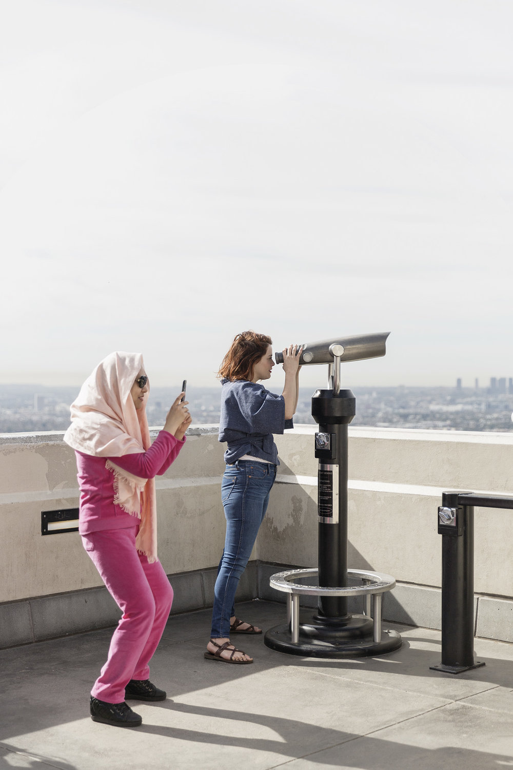 Two women enjoy the view of Los Angeles from the Griffith Observatory by Denver Boulder Colorado Editorial and Commercial Photographer Rebecca Stumpf, specializing in food, lifestyle, and travel photography.
