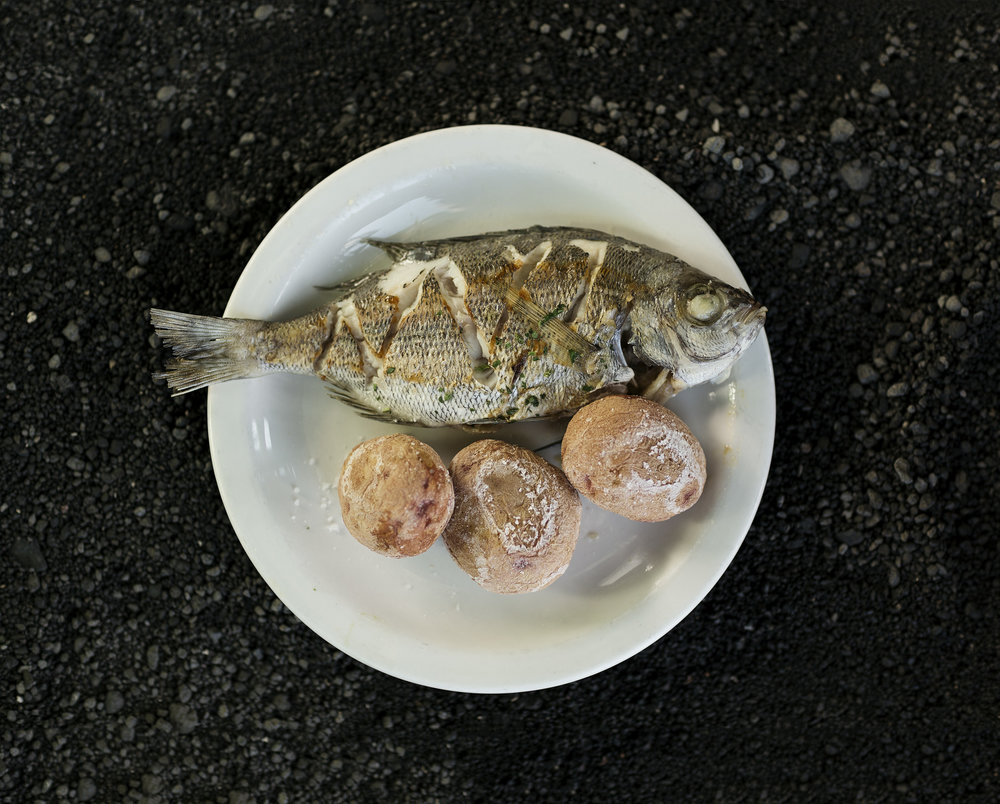 A typical meal of grilled fish and salted potatoes in the Canary Islands by Rebecca Stumpf, Denver Boulder Colorado Editorial and Commercial Photographer.