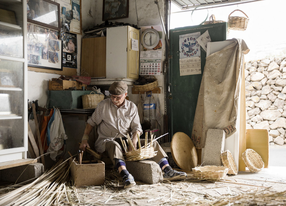 A man weaves baskets in his studio on Lanzarote in the Canary Islands by Rebecca Stumpf, Denver Boulder Colorado Editorial and Commercial Photographer.