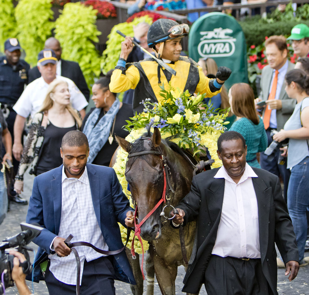 "Uriah St. Lewis - Equithrive Trainer of the Quarter  By Bill Heller  What could possibly be better for a trainer than winning his first Grade 1 stakes? Owning that horse and getting a free trip into the $6 million Breeders' Cup Classic.  Three days after Uriah St. Lewis' five-year-old Discreet Lover captured the $750,000 Grade 1 Jockey Club Gold Cup by a neck at odds of 45-1, St. Lewis, who said he bet $200 across the board on him, was still smiling. Who wouldn't?  ""I really thought I could win the race,"" St. Lewis said. ""He always gives me everything he's got.""  Now Discreet Lover, whom St. Lewis bought for $10,000 as a two-year-old in training at Timonium in Maryland, will take him to the biggest race of the year for older horses at Churchill Downs. This is heady stuff for St. Lewis, a 60-year-old native of Trinidad who used to literally run to Aqueduct to bet on a couple of races after he was done for the day at Clinton High School in Brooklyn, where he ran on the track team. ""You can actually see the racetrack from the roof of the high school,"" he said.  St. Lewis was 15 when his family moved to Brooklyn in 1973.  Ten years earlier, his older sister had taken him to the track for the first time. ""I remember like it was yesterday,"" St. Lewis said. ""In Trinidad, they have Boxing Day a day after Christmas. I was five. She took me to the races, and I saw this gray horse. I fell in love with the gray horse. I was hooked.""  Eventually, he would work for AmTote as a computer technician and wager on Thoroughbreds regularly. He wasn't doing well. ""I didn't have a clue. My wife says, `You're just throwing your money away. Why don't you learn about the business?'""  So he did. He went to Oklahoma with his family, purchased an 88-acre ranch and began to learn about training. He was instructed to buy his own horses to train, and that's what he did. ""I bought two horses for $5,000,"" St. Lewis said.  He became a trainer in 1988. His family's real estate business in Brooklyn and his wife's job as a registered nurse financed their equine business, which they operate as a family, including their 23-year-old twin son and daughter. ""We're all hands on,"" St. Lewis said. ""We do everything ourselves, because I know it's done right if I do it myself. We work a lot in the afternoons and evenings. We've been having success with it. We aren't going to change.""  But he did take a near-sabbatical, winning just 14 races from 2006 to 2013 as he shepherded his twins through high school. ""I stopped for a while to make sure my kids finished high school and got to college,"" St Lewis said. ""The day they went to college, I started back in. I really started to get serious about racing.""  Now they have 28 horses based at Parx led by a certified superstar. Discreet Lover had made more than $940,000 before the Jockey Club Gold Cup, when he cashed in on a hot pace. ""When I saw :22, :45 and 1:09, I said, `Unless they're super horses, they're going to stop,'"" St. Lewis said. ""He picked them up real quick. He ran his heart out.""  Asked why he had bought Discreet Lover, St. Lewis said, ""He was the first baby from his dam. I like buying first foals. You don't know what you're going to get. What the hell? Take a chance.""  That chance had him standing in the winner's circle after the Jockey Club Gold Cup and heading for the Breeders' Cup Classic. That's a long way from Trinidad."
