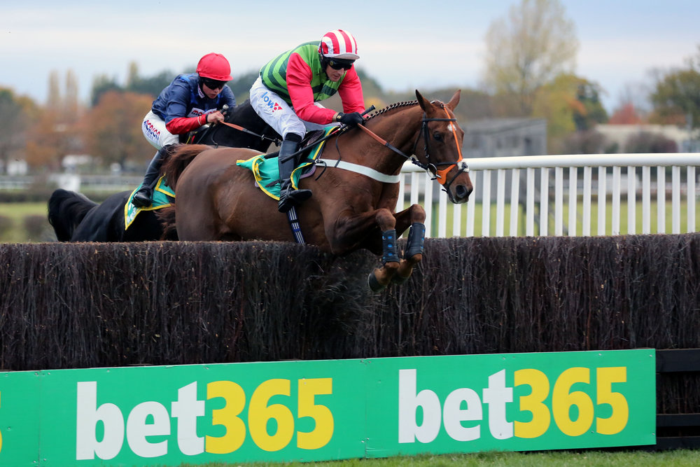 Definitly Red ridden by Danny Cook jumps the last fence before going on to win the Bet365 Charlie Hall Chase at Wetherby Races.
