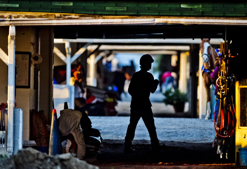 LOUISVILLE, KY - APRIL 30: A exercise rider walks the barn area waiting for his next ride during morning workouts at Churchill Downs on April 30, 2018 in Louisville, Kentucky. (Photo by Scott Serio/Eclipse Sportswire/Getty Images)
