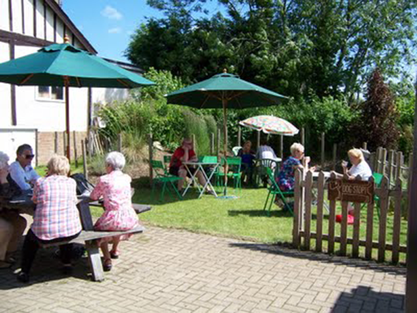The Shop has a lovely garden to sit and enjoy fresh sandwiches, cake, coffee of tea from the coffee shop