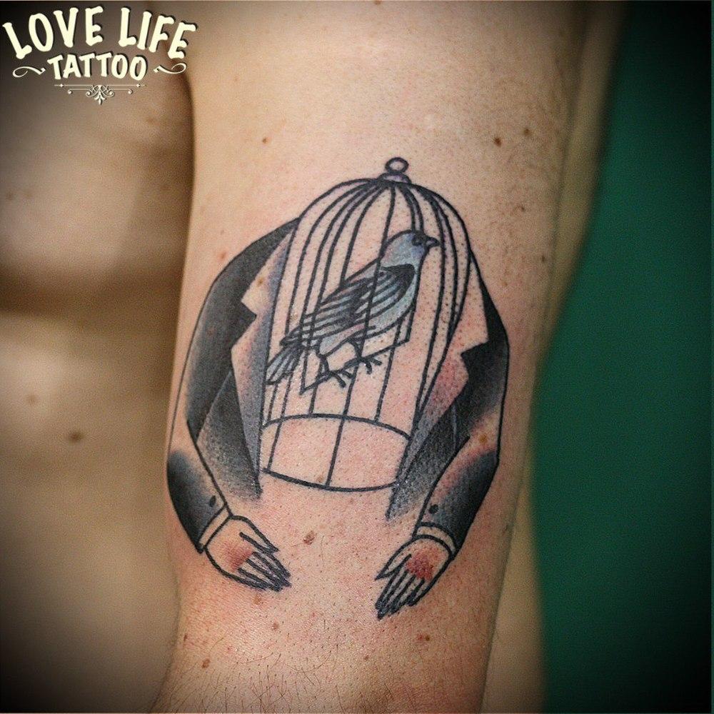 татуировка птица в клетке