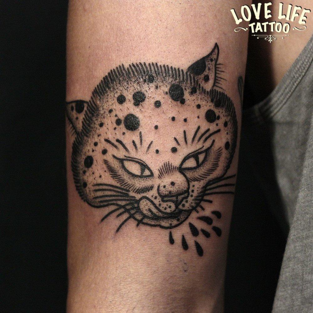 татуировка головы кота
