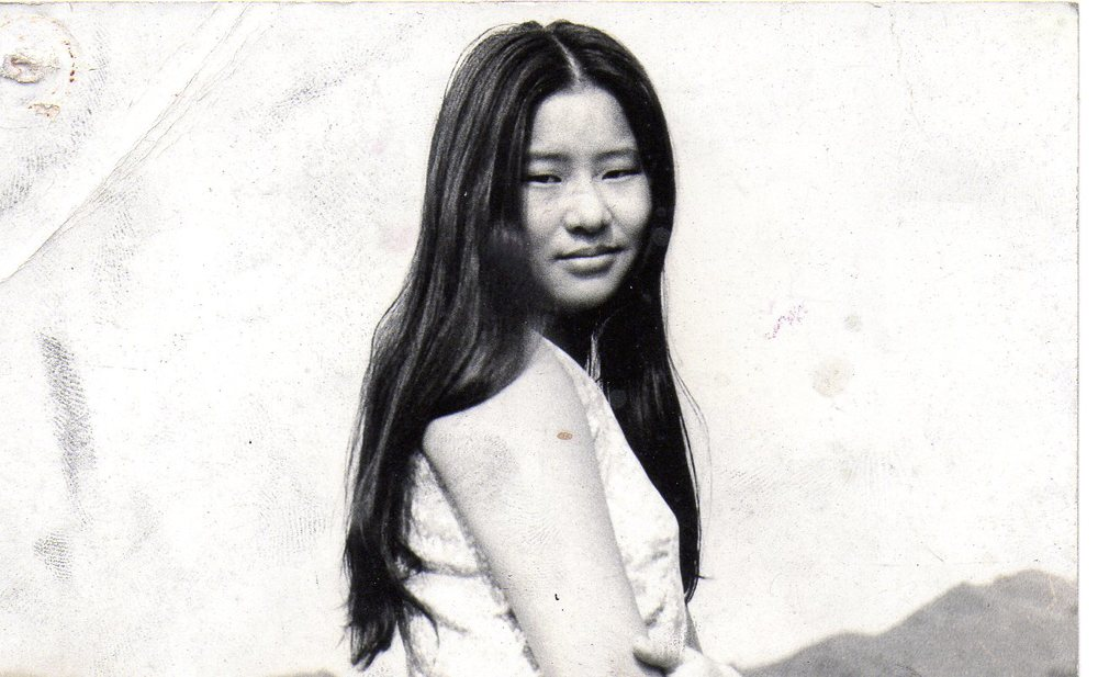 Taiwan, 1969. My mother at nineteen years old wearing a tailor made dress purchased for her after high school graduation.