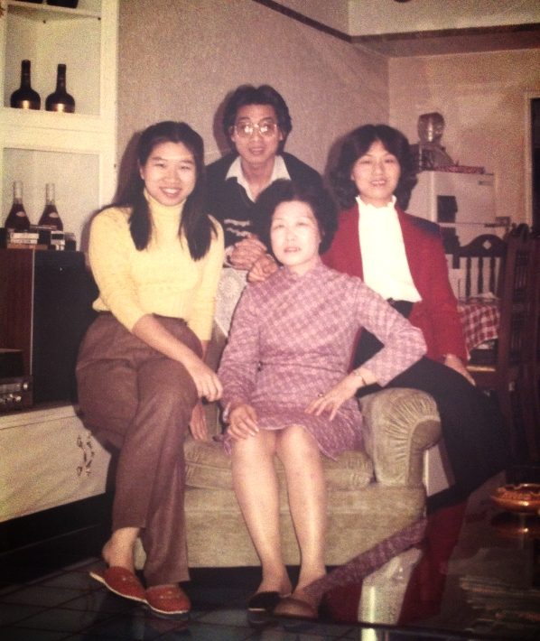 My mother (far left), as a young woman sitting with my uncle, aunt, and grandmother in their apartment in Taipei, Taiwan.
