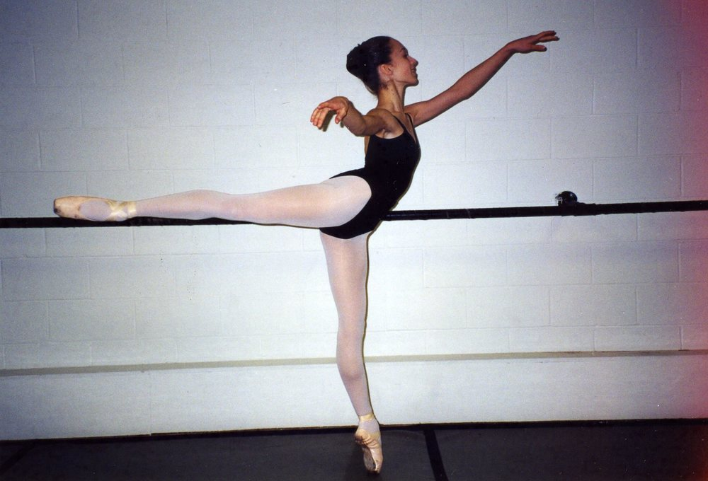 Arabesque at the barre, age 13.