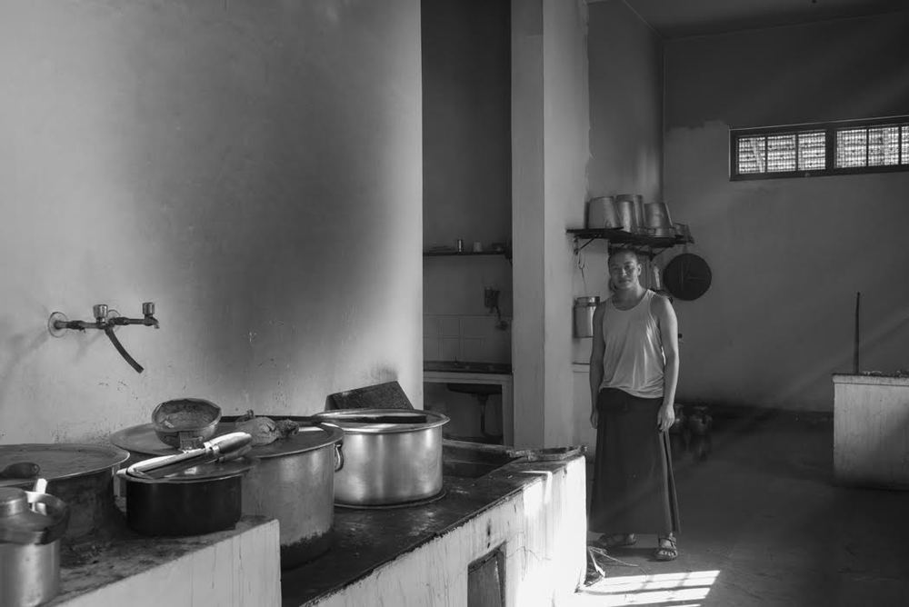 Head of the kitchen, Venerable Lobsang Tenzin with our wood burning stove